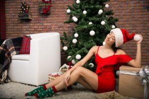 Girl on Christmas with presents